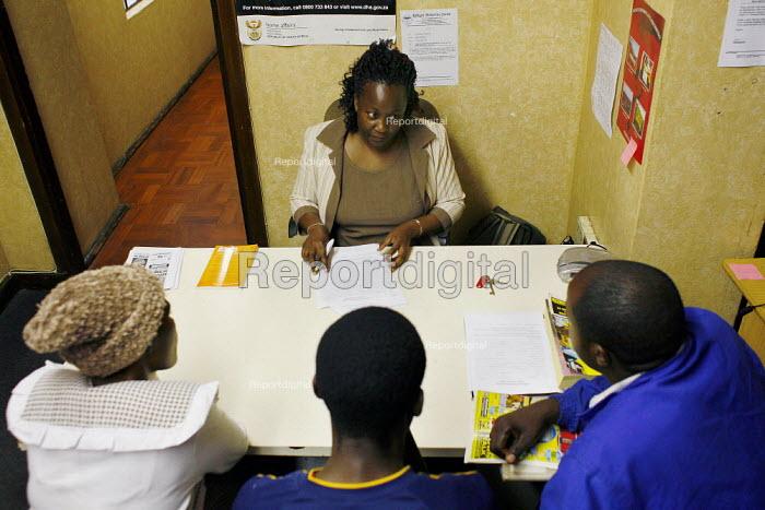 Johannesburg, South Africa. Three Zimbabweans seek advice in the office of the Ministry of Refugees Centre (MRC) in Johannesburg. - Felipe Trueba - 2008-03-03