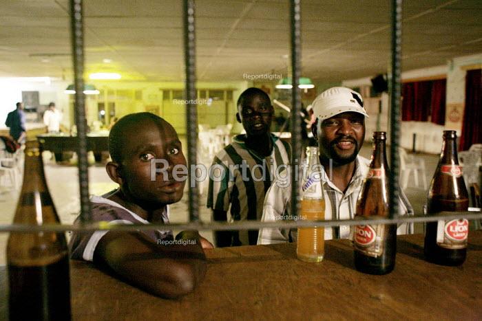 Harare, Zimbabwe. Unemployed Zimbabweans in a bar in Warren Park, outside Harare. - Felipe Trueba - 2007-11-20