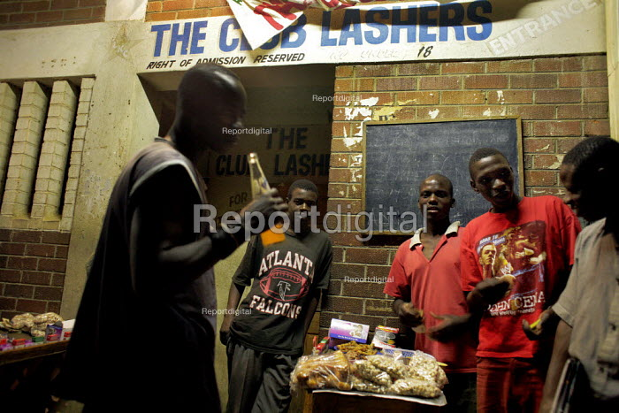 Harare, Zimbabwe. Unemployed Zimbabweans in a bar in Warren Park, outside Harare. A few food items are for sale. - Felipe Trueba - 2007-11-20