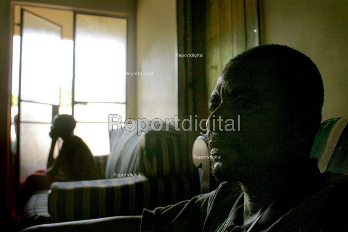 A HIV positive man in his house in near Warren Park, in the outskirts of Harare, Zimbabwe. Zimbabwe is the only country in the world with a tax specifically created to tackle the HIV problem. These funds, however, are redirected into other matters and the HIV cases in Zimbabwe remain very high. Due to the crisis in the country many patients do not receive the proper treatment as medical supplies are scarce. - Felipe Trueba - 2007-11-21
