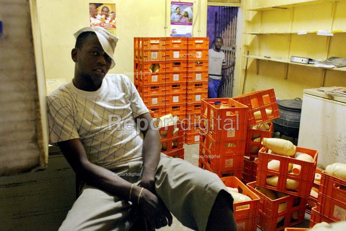 A shopkeeper in front of the empty crates of the local maize beer in Bulawaya, Zimbabwe. - Felipe Trueba - 2007-11-21