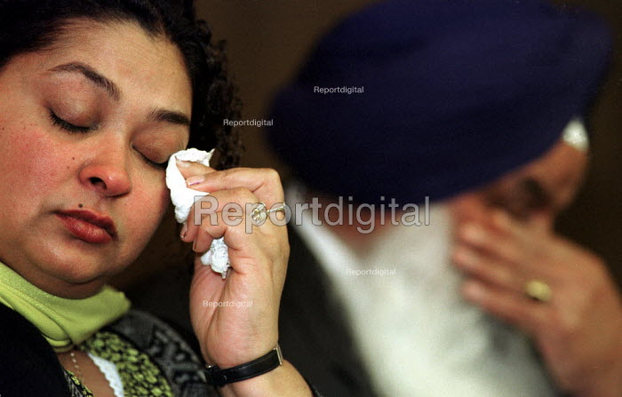 Relatives of murdered Sikh waiter Surjit Singh Chhokar break down at a rally in Glasgow calling for a new public inquiry into his death. Sister Manjit Kaur and father Darshan Singh Chhokar have withdrawn their support from the current inquiry. - Gerry McCann - 2001-01-13