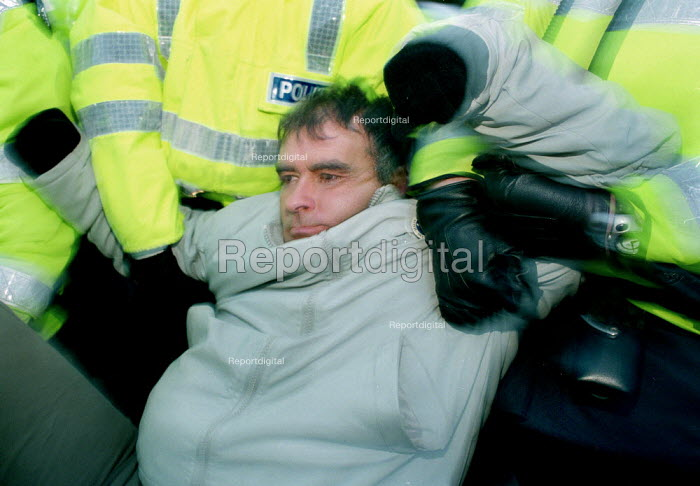 MSP Tommy Sheridan is arrested by Police after joining in the blockade of the Faslane Nuclear base. - Gerry McCann - 2001-02-12