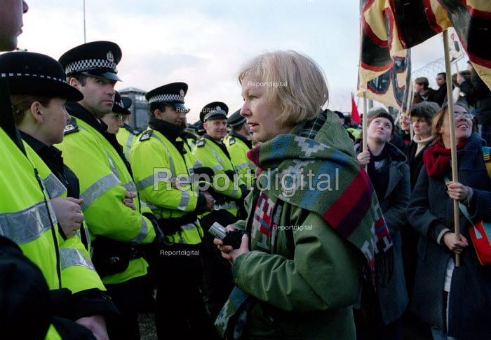 A woman confronts the Police after joining in the blockade of the Faslane Nuclear base. - Gerry McCann - 2001-02-12