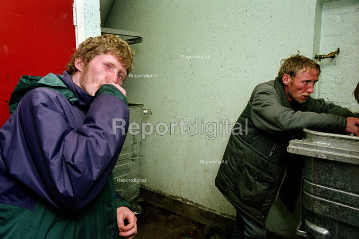 A homeless man prepares to spend the night in the bin shelter of a block of flats in Glasgow. He lives with his brother on the streets and both admit to abusing heroin. - Gerry McCann - 2002-09-22