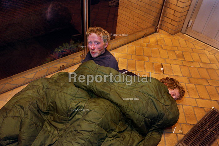 Two men sleep rough at the entrance to modern buildings in one of Glasgow. The men are brothers and have been drug users and homeless for several years. - Gerry McCann - 2002-09-22