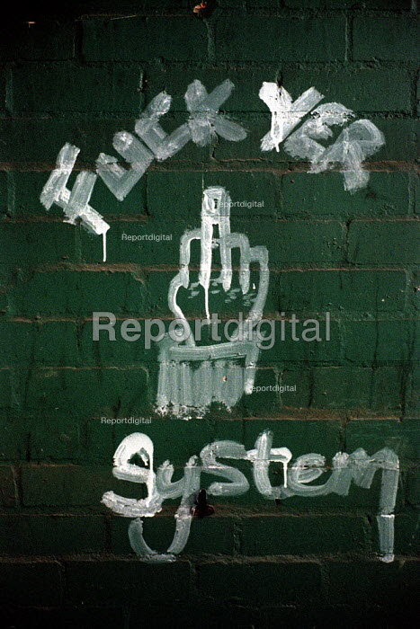Fuck the system. Graffiti found in a disused factory now used for rough sleeping by homeless people in Glasgow. - Gerry McCann - 2002-07-22