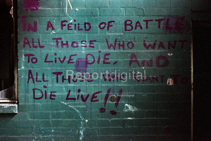 Graffiti found in a disused factory now used for rough sleeping by homeless people in Glasgow. In a field of battle all those who want to live die and those who want to die live! - Gerry McCann - 2002-07-22