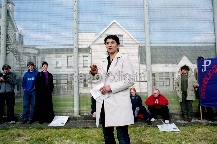 Robina Quereshi of Positive Action on Housing addresses protesters at Dungavel Prison near Strathaven in Scotland. The privately run prison is being used as a detention centre for asylum seekers. - Gerry McCann - 2002-03-17