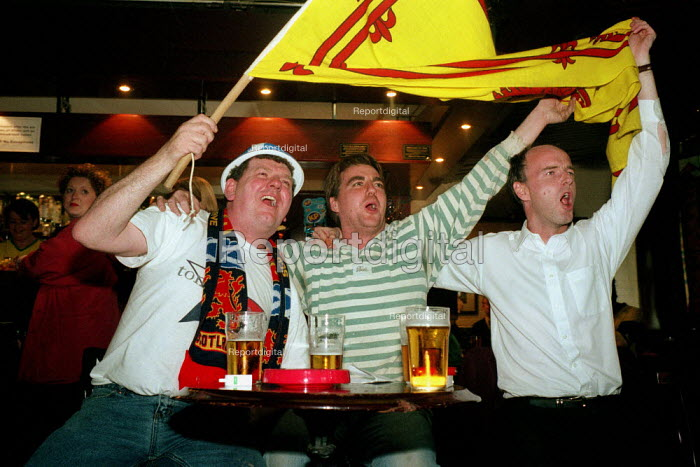 Scottish football supporters celebrate while watching the... - Gerry McCann, G0210007.jpg