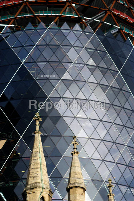 Overshadowing the church of St Andrews Undershaft, the Swiss Re Building on the site of the Baltic Exchange at 30 St Mary Axe. AT 40 floors high, the building will be 590 ft/179.8 metres high. It is due for completion in the fourth quarter of 2003. Swiss Re will move in during the first quarter of 2004. - Geoff Crawford - 2002-11-12