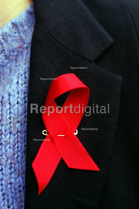 Campaigner with AIDS leaflets and AIDS ribbon on jacket lapel. World AIDS day 1st December 2002 - Geoff Crawford - 2002-11-28