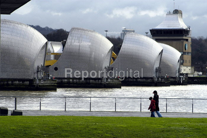 The Thames Barrier. A woman and child walk along the bank of the riverThames - Geoff Crawford - 2003-01-02