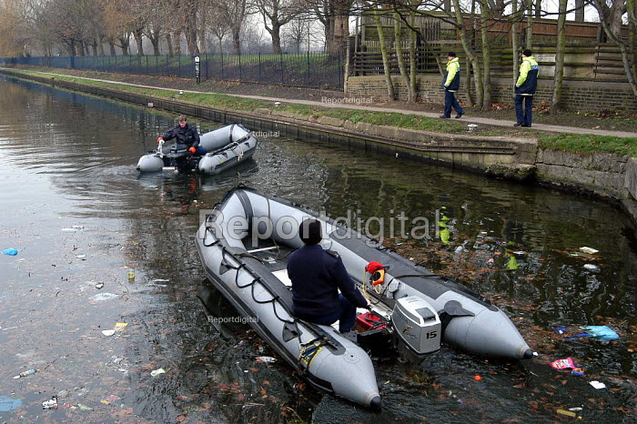 Police dinghies at a reconstruction of the murder of Margaret Muller, a 27 year old artist from America. Margaret was stabbed to death on 3rd of February 2003, in Victoria Park in Hackney in London. - Geoff Crawford - 2003-03-03