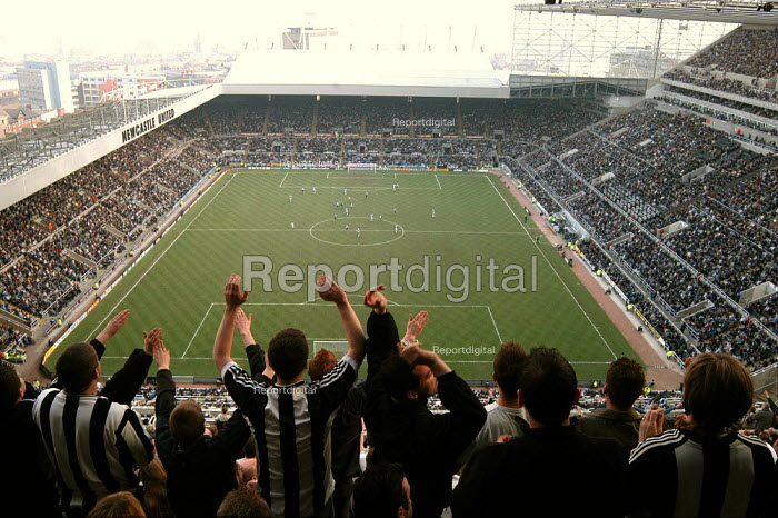 Newcastle fans in the Sir John Hall stand, celebrate a goal. Premiership football game Newcastle United v Blackburn Rovers. 22 March 2003 - Geoff Crawford - 2003-03-22