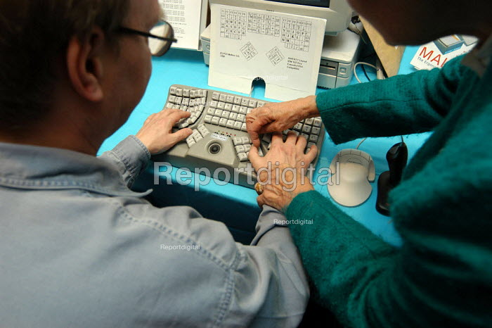 Delegate being shown how to use an Ergonomic keyboard at... - Geoff Crawford, GC030327.jpg