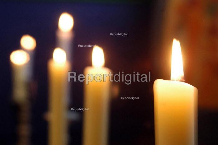 Candles burning at St Luke's Church Holloway, London. - Geoff Crawford - 2003-02-16