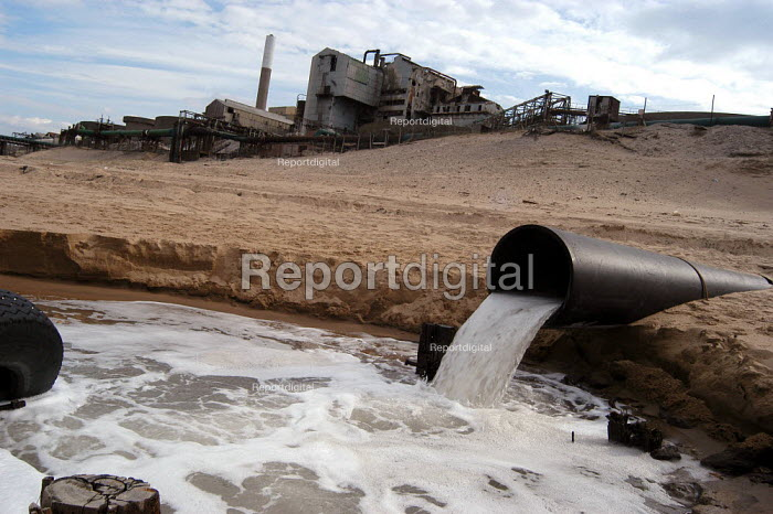 An outlet pipe pours liquid in to the North Sea at the derelict Steetley Magnesite works, North Sands in Hartlepool - Geoff Crawford - 2003-03-12