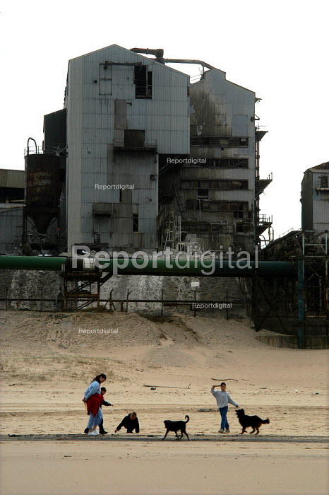Children walking their dogs on the beach infront of the derelict Steetley Magnesite works, North Sands, Hartlepool - Geoff Crawford - 2003-03-12