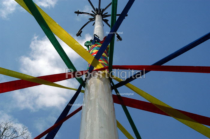 Children of Long Preston Primary School in North Yorkshire practise the maypole dance for the May Day celebrations. - Geoff Crawford - 2003-04-11