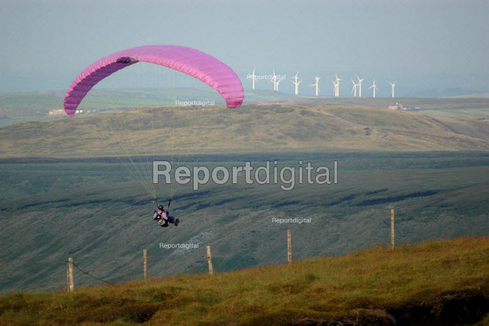 Paraglider landing at Shining Tor in the Peak District National Park. A windfarm can be seen in the distance. - Geoff Crawford - 2002-08-05