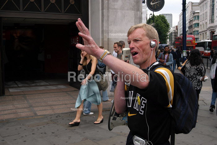 Preacher Phil Howard exercises his right to free speech at Oxford Street. His mission is to 'make London the safest capital in the world.' - Geoff Crawford - 2003-07-04