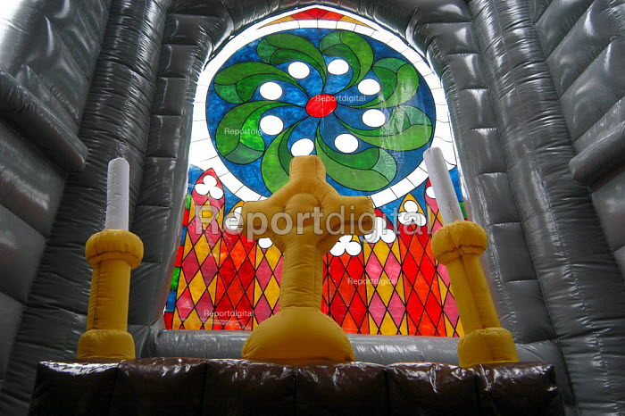 Inflatable candles and crosses on the inflatable altar in the inflatable church at the Christian Resources Exhibition at Sandown. Designer Michael Gill says the church, which stands 14 metres (47 ft) high to the tip of its steeple, could transform the Anglican Church. - Geoff Crawford - 2003-05-14
