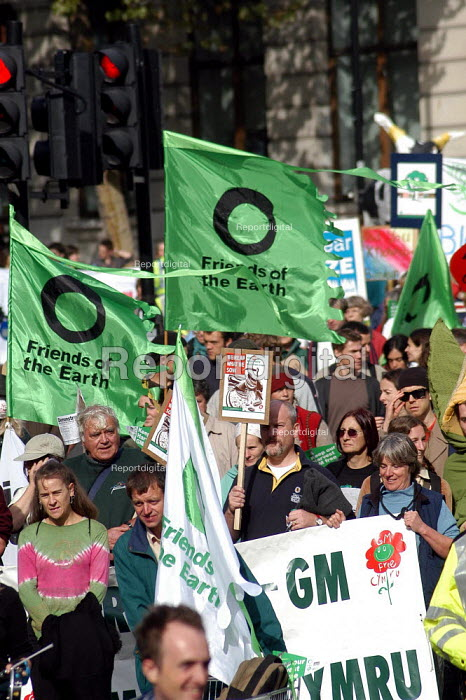 Protesters carrying Friends of the Earth banners march down Shaftesbury Avenue during a march against GM food production. London, October 13th 2003 - Geoff Crawford - 2003-10-13