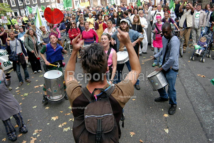 Drummers play outside the Headquarters of DEFRA in Smith square during a protest march against GM food production in London. Red placard reads - Fork Off Our Food. October 13th 2003 - Geoff Crawford - 2003-10-13