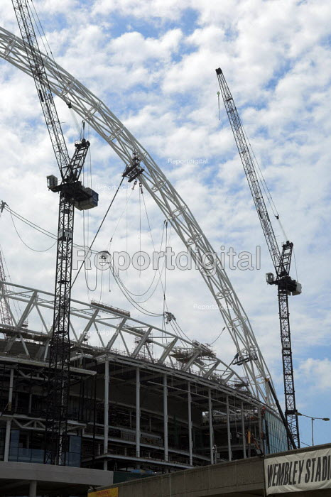 Construction of the New Wembley Stadium. Despite predicting a �45m loss on the project. Multiplex, the Australian property firm building the stadium has insisted it will be finished in time for the FA Cup final in 2006 - Geoff Crawford - 2005-06-03