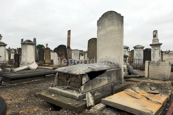 Damaged gravestones at West Ham Jewish cemetery in Stratford, east London. Over 80 stones were pushed over and the door to the Rothschild family mausoleum was smashed in a racist attack - Geoff Crawford - 2005-06-16