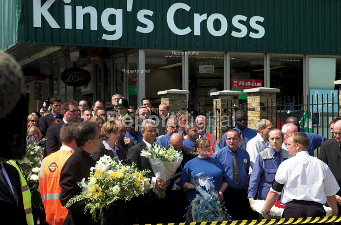 Religious leaders and underground workers join other mourners at Kings Cross for a two minutes silence, one week after the terrorist bombings in London. - Geoff Crawford - 2005-07-14