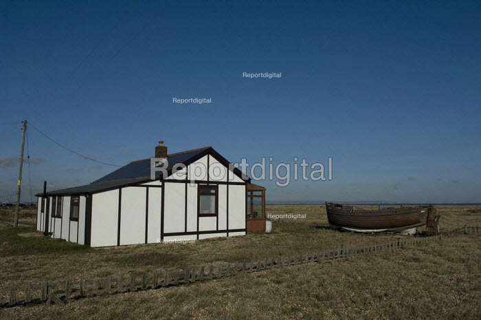 Wooden house and boat at Dungeness, Kent, England - Geoff Crawford - 2008-01-30
