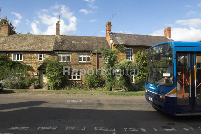 The number 59 bus in Adderbury village near Banbury, Oxfordshire. The bus serves villages in the Banbury area - Geoff Crawford - 2005-08-20