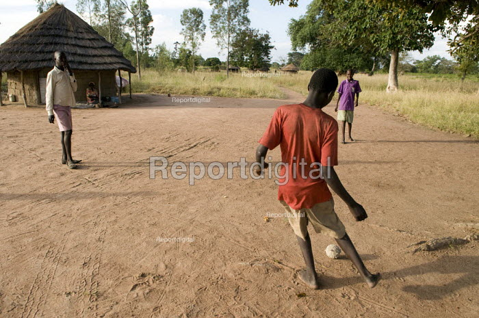 Boys play football with a rag ball in Norungatuny village in the Amuria district of Uganda near Soroti. - Geoff Crawford - 2010-02-08