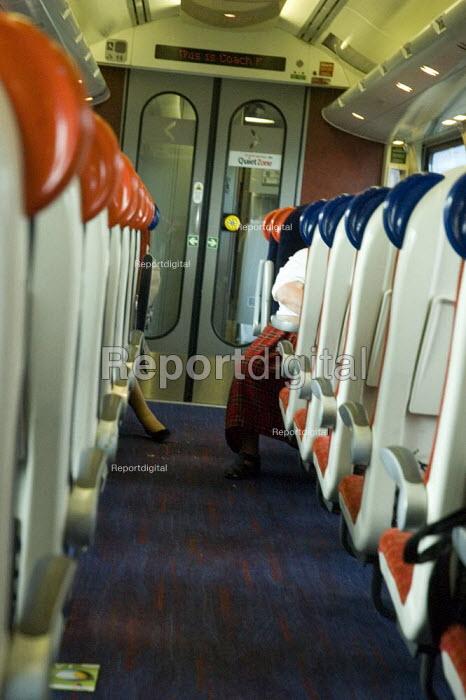 Passengers on Virgin train - Graham Howard - 2006-05-12