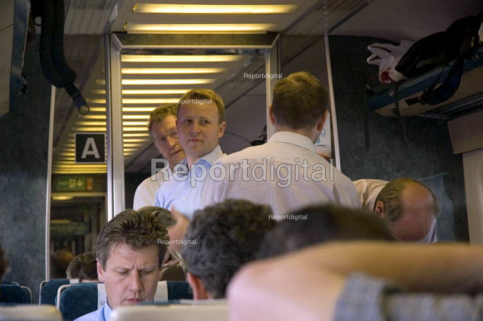 Commuters looking for seats on a crowded train - Graham Howard - 2006-05-12