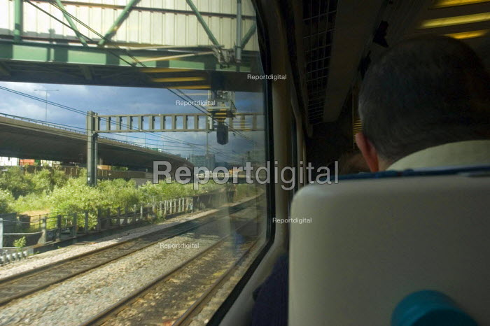 Commuter on train passing flyover and signals - Graham Howard - 2006-05-12