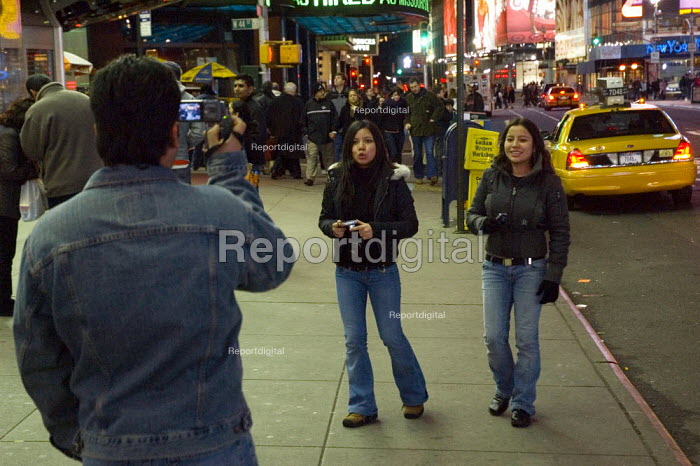 Tourist videoing others in Times Square, New York - Graham Howard - 2006-05-12