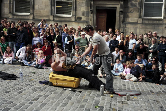 Thousands of street performers like this strongman put on their shows in the Royal Mile during the Edinburgh Festival. - Gerry McCann - 2006-08-09