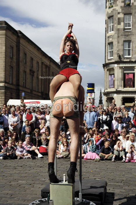 Thousands of street performers like these acrobats put on their shows in the Royal Mile during the Edinburgh Festival. - Gerry McCann - 2006-08-09