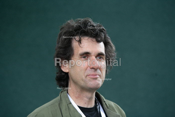 Geraint Lewis, photographer, poses for pictures during the Edinburgh Book Festival. - Gerry McCann - 2006-08-13