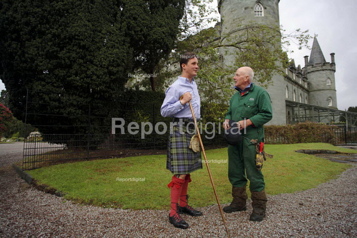 Torquhil Ian Campbell otherwise known as the Duke of Argyll, wearing a kilt and photographed with his gardener at Inverary Castle, Argyll, Scotland. - Gerry McCann - 2006-05-19