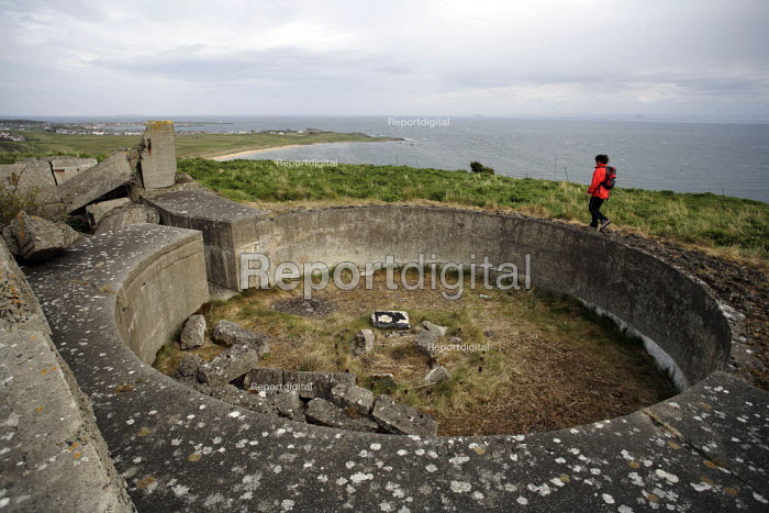 Walker on the approach to the Elie Chain, on the Fife coast of Scotland. It is thought to be the only Via Ferrata style path in the country. Here the path goes past the remains of World War Two gun emplacements. - Gerry McCann - 2006-05-14