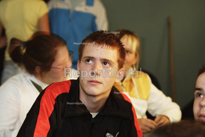 Young people seen at the Castlemilk Youth Complex in Glasgow. Many are vulnerable and the staff try to offer them support. Here they are watching a film about local youths who have been convicted of murder and who are currently in prison. - Gerry McCann - 2006-05-17