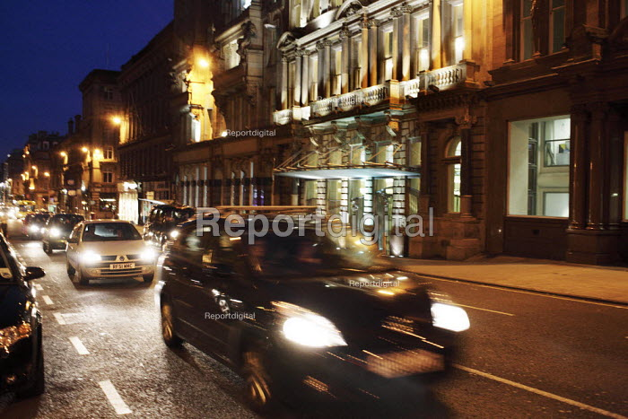 Taxi, cars, and buses take on an eerie and surreal appearance at night in Glasgow city centre. - Gerry McCann - 2006-06-07
