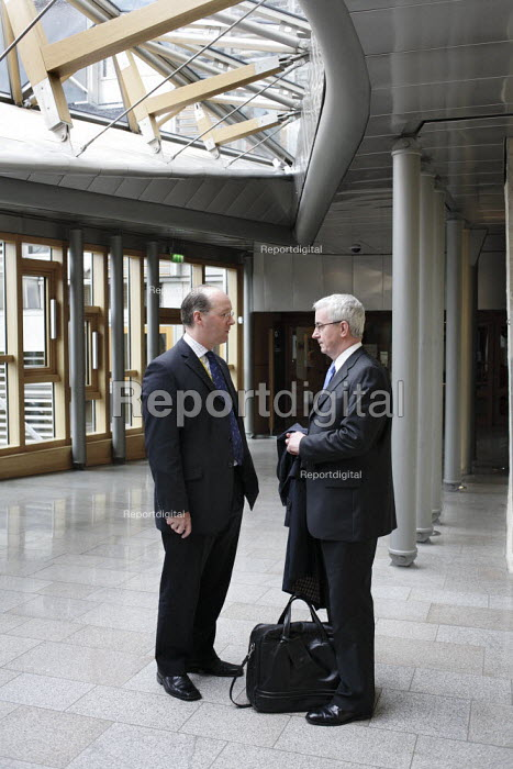 MSPs John Swinney, left and Des McNulty in discussion in the foyer of the Scottish Parliament. - Gerry McCann - 2006-05-24