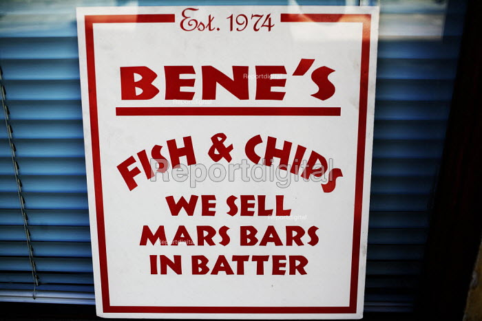 A sign in a chip shop window advertises Deep fried Mars Bars. The shop is on the Royal Mile, near to the Scottish Parliament. - Gerry McCann - 2006-06-03