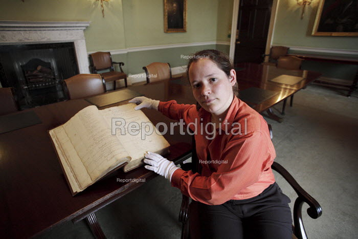 Ruth Reed senior archivist at the Royal Bank of Scotland HQ in Edinburgh. Here she is holding a centuries old book. - Gerry McCann - 2006-06-13