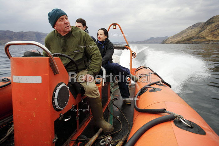 Ian Robertson is one of the long-time residents of the Knoydart Peninsula in North-West Scotland. As well as running a RIB (Rigid Inflatable Boat) he is the co-owner of the Old Forge, the most remote pub in mainland Britain. Here he is taking visitors on a tour of Loch Nevis. - Gerry McCann - 2006-05-03